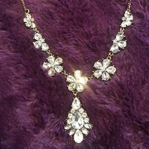 Sparkly crystal necklace on golden chain